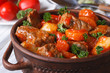 stew in tomato sauce with vegetables close up in a pot - 72805212