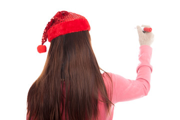 Back of Asian girl with christmas hat wirte with red pen