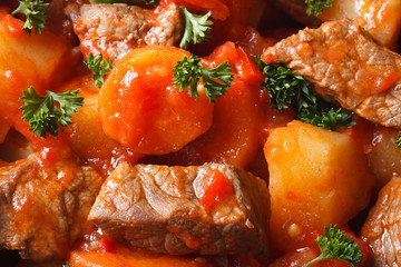 stew with vegetables in a tomato macro. Background