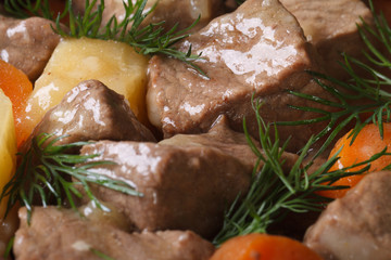 stew with vegetables and dill close-up. background horizontal