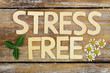 canvas print picture - Stress free written with wooden letters on rustic wood