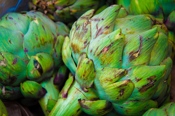 Fresh green artichokes in the market