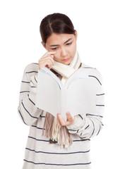 Beautiful Asian girl with scarf  read a sad book