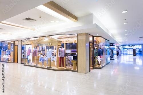 Leinwandbild Motiv modern clothes retail shop in shopping mall
