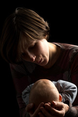 Dark portrait of a loving mother and baby