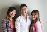 Group portrait of 3 happy Asian people.