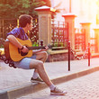 Young man with guitar outdoor