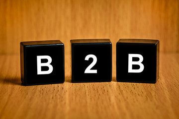 B2B or Business-to-business word on black block