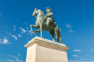 Statue of Louis XIV in front of versailles palace, France