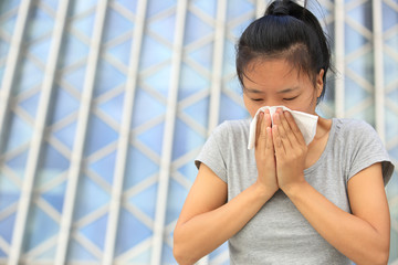 cough woman sneeze nose outdoor