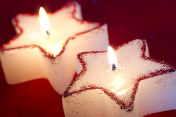 Christmas candle star in red closeup