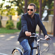 Young stylish man on a vintage bike