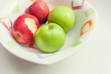 bitten apple in bowl
