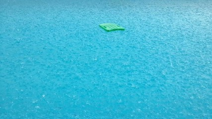 Raining at swimming pool with swimming board