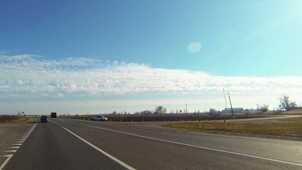road under blue sky with sun