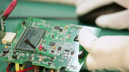 Electronic circuit board in human hands