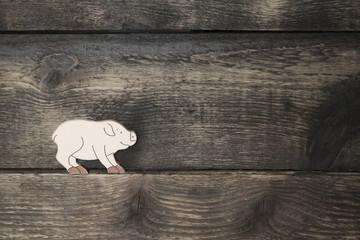 Schwein auf Holz