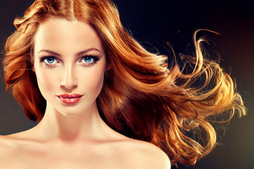 Beautiful model with long curly red hair