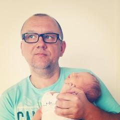 Proud father love newborn baby son hug