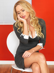 Attractive Bored Business Woman Sitting in a Chair