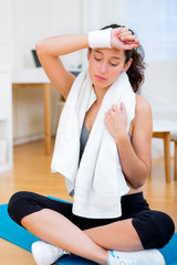 Portrait of an attractive girl having rest after sport