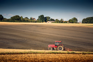Tractor harrowing a field west of Poitiers in south western Fran