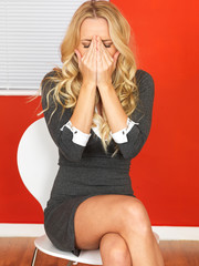 Shocked Business Woman Sitting in a Chair