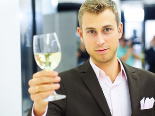 Man toasting on a party