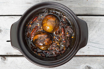 Caramelized balut, boiled developing duck embryo in a clay pot