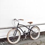 Cruiser bicycle near a white wall