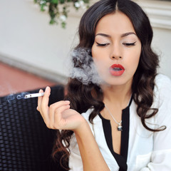 Smoking girl outdoor fashion portrait