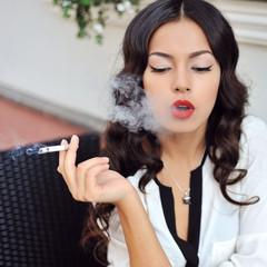 Smoking girl outdoor fashion portrait