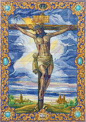 Seville - The ceramic tiled Crucifixion on the church facade