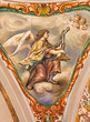 Seville - baroque fresco of angel with the symbolic cross