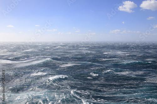 Rough seas and blue sky