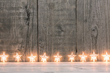 Star lights against wooden background