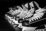 Hockey skates lined up in locker room - 72823428