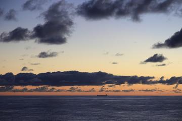 Lone Oil Tanker ship on the horizon at sea