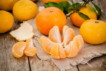 fresh organic tangerines and peeled slices
