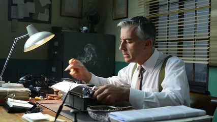Vintage journalist working late at night at office desk, typing