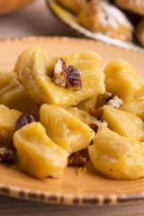 homemade pumpkin gnocchi with pecan nuts