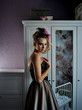 portrait photo of beautiful dressed girl standing near closet
