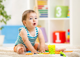 kid boy playing with block toys indoors poster
