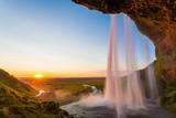 Seljalandsfoss, waterfall in Iceland, sunset and sunstar