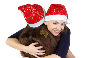 Portrait of two hugging young women