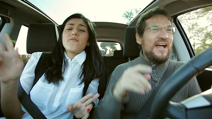 Cool man and woman having fun dancing in car going in vacation