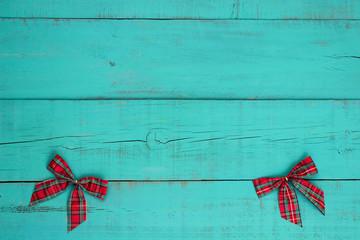 Christmas bows border antique blue wood background