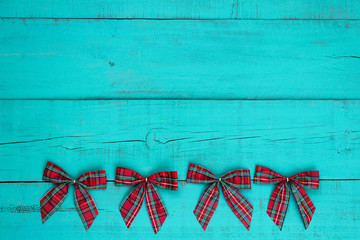 Christmas bow border on antique blue wooden background