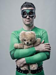 Lonely superhero holding a teddy bear