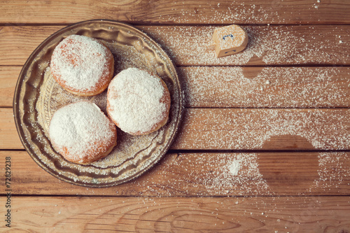 Jam doughnuts with icing sugar for Hanukkah holiday celebration